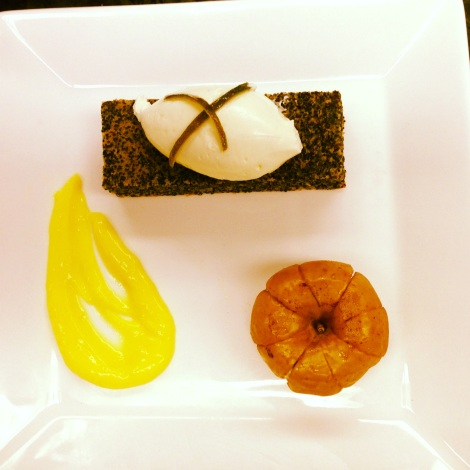 Poppyseed cake topped with a quennelle of whipped cream, a schmear of lemon curd, and a baked apple