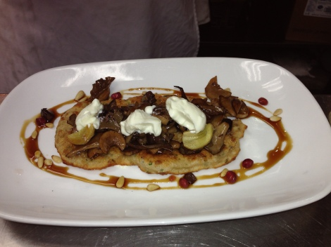 The Vegetarian Entree: herb flatbread topped with mushrooms, eggplant, garlic confit, and garlic yogurt.