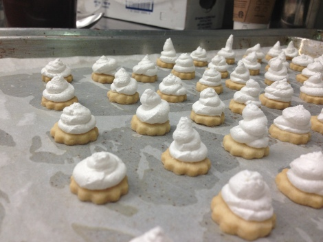 Butter cookie topped with Swiss meringue.