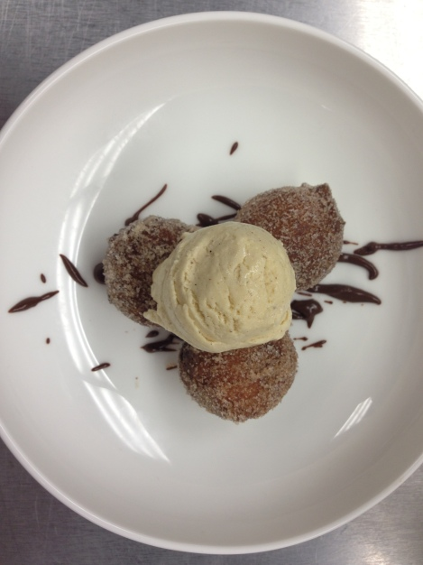 cardamon doughnuts with cinnamon ice cream and a splattering of chocolate sauce